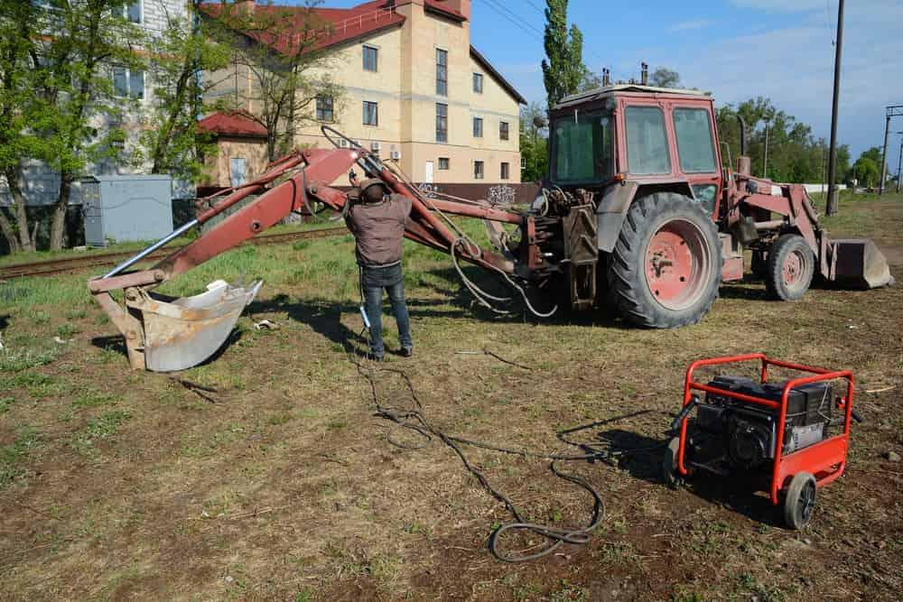 Welder working with a Diesel Engine Driven Welder Generator